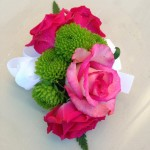 hot pink roses with green poms corsage