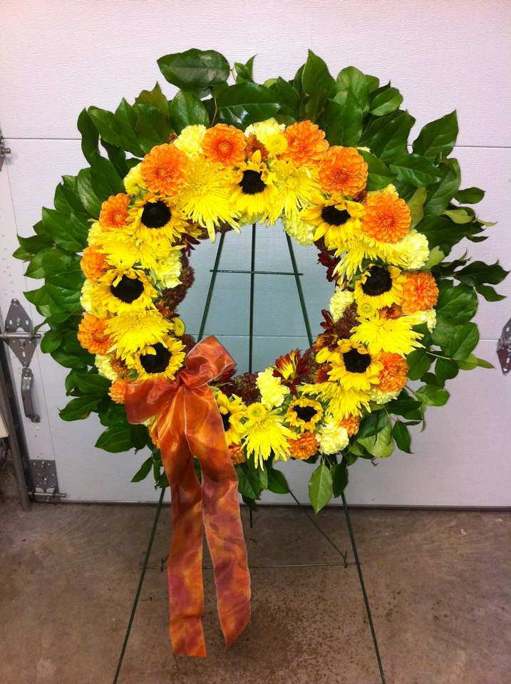 memorial wreath with sun flowers, dahlias, and mums