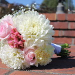 Bridal bouquet with white and pink dahlias, pink roses, pink Alstromeria and baby's breath