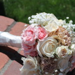 Bridal bouquet with blush flowers, of carnations, roses, Ivory Vendella roses, and Baby's breath.
