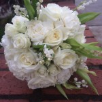 white bride's bouquet with roses and snowdrop flowers