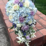 cascading blue hydrangea and orchid brides bouquet