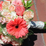 coral gerbera and peach roses bridal bouquet