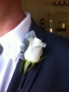 white rose with dusty miller boutonniere