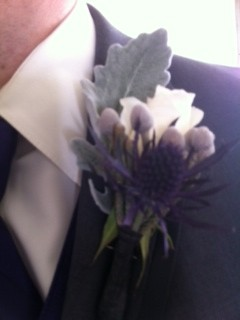 bout with white rose, thistle, dusty miller