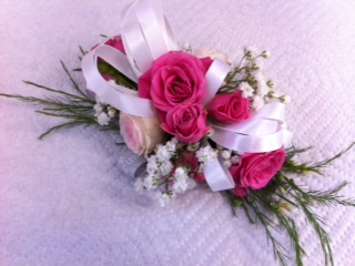 corsage with hot pink roses and babysbreath gypsophelia