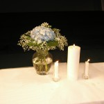 Unity candle with blue hydrangea