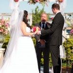 wedding ceremony with flower swag with baroneese garden roses