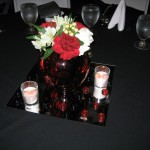 table centerpiece with red carnation, and white roses