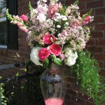 Event bouquet with pink garden roses, white hydrangea and wax flower