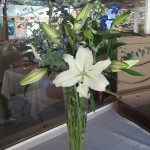 wedding reception bouquet with blue delphinium and white lily