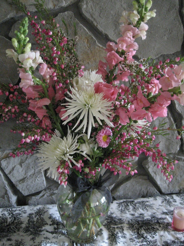 wedding bouquet with pink roses, white spider mums, and pink snapdragons