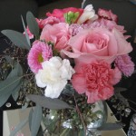 wedding reception centerpiece with pink roses
