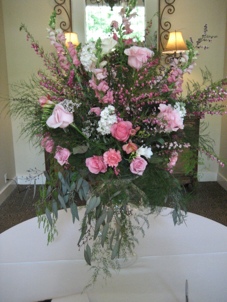 Pink roses, pink snapdragons and white wedding reception bouquet