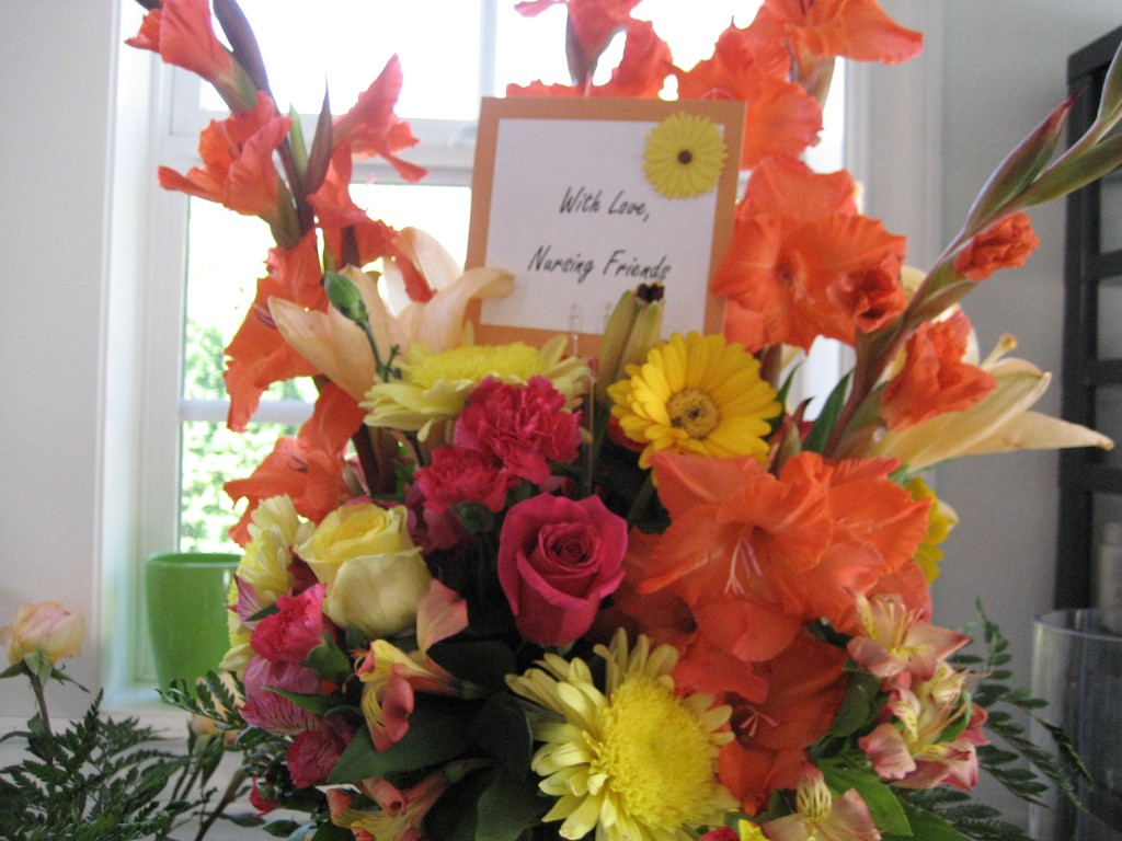 memoral bouquet with roses, gladiolius, gerbera daisy and mums