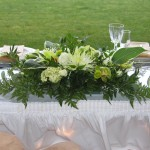 head table bouquet with hosta, green orchid and mums