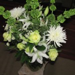 Ceremony bouquet with green roses, white lily