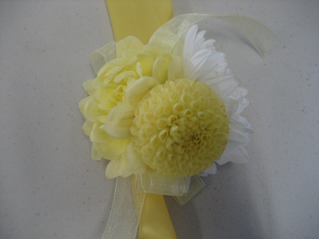 yellow and white dahlia corsage