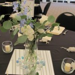 Blue centerpiece with blue delphinium with white phlox and rose