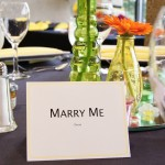 Colored vases with gerbera daisy wedding reception